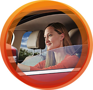 Woman in car with window film